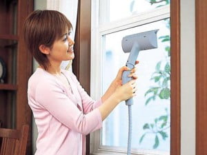 Steam Clean glass surfaces and windows with the steam cleaner