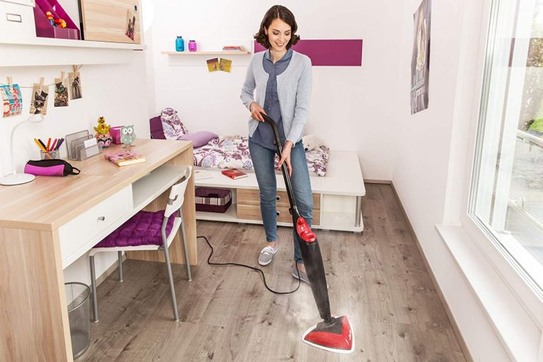 clean wooden floor using steam mop